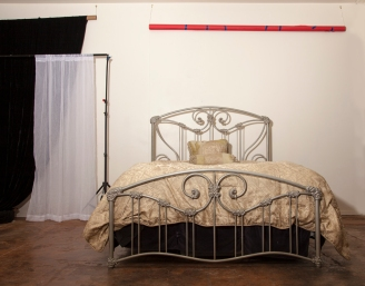 Queen size bed with several colors of sheets for bedroom & boudoir sets.