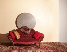 Beautiful red velvet couch and rugs.