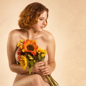 Woman holding fresh sunflowers.